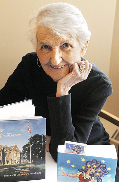 "Jean Steiner poses with her books. Steiner transformed the ""Office of House Public Information"" into a permanent and valued fixture at the House. (Photo by Andrew VonBank)"