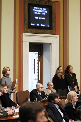 Rep. Bernie Lieder, back center, watches as the Feb. 25 vote to override Gov. Tim Pawlenty