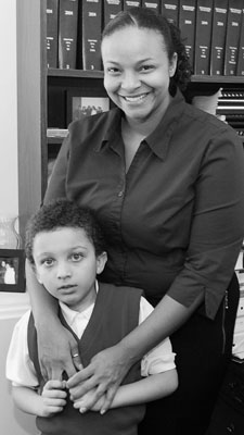 Rep. Neva Walker enjoys the company of her best friends� nephew, Kenney Gatlin Jr., in her State Office Building office. (Photo by Andrew VonBank)