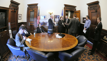 House and Senate leadership meet in the conference room just off Gov. Tim Pawlenty�s office prior to a May 18 news conference to announce a budget deal. This is the room where legislative leaders and Pawlenty spent most of the end of the 2008 legislative session working out the budget agreement. In attendance, from left, Senate Majority Leader Larry Pogemiller, Senate Minority Leader David Senjem, Senate Assistant Majority Leader Tarryl Clark, Finance Commissioner Tom Hanson, House Speaker Margaret Anderson Kelliher, Rep. Tom Emmer, Pawlenty�s Press Secretary Brian McClung, Pawlenty and House Majority Leader Tony Sertich. (Photo by Tom Olmscheid)