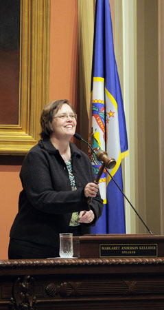 With a jubilant grin, House Speaker Margaret Anderson Kelliher brings down the last gavel of the 2008 session at 11:45 p.m. May 18. (Photo by Andrew VonBank)