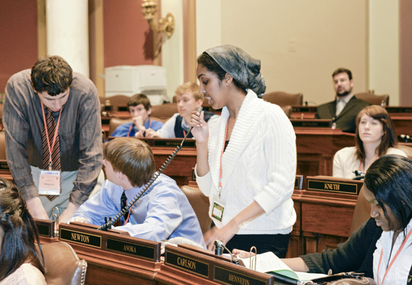 Nima Hassan, a junior at Fridley High School, proposes a bill during a youth in government assembly.