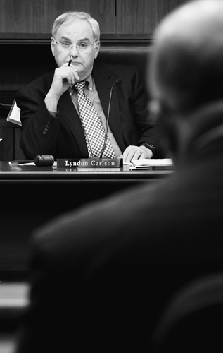 Rep. Lyndon Carlson, chairman of the House Finance Committee, listens as Tom Hanson, commissioner of Minnesota Management and Budget, presents Gov. Tim Pawlenty's 2010-2011 biennial budget proposal Jan. 28 to a joint hearing of the House Finance and Ways and Means committees.