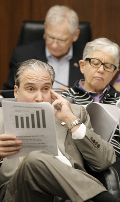 Rep. Michael Paymar, from bottom, Rep. Phyllis Kahn and Rep. Thomas Huntley follow a budget handout March 4 as State Economist Tom Stinson reviews the February Forecast with members of the House Ways and Means and Finance  committees. (Photo by Tom Olmscheid)