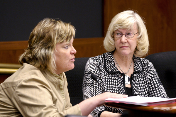 Barb Anderson, a former teacher, listens as Lorie Alveshere, policy director for the Minnesota Organization on Adolescent Pregnancy, Prevention and Parenting, tells the House K-12 Education Policy and Oversight Committee that 22 states have abandoned an abstinence-only curriculum of sex education. (Photo by Tom Olmscheid)