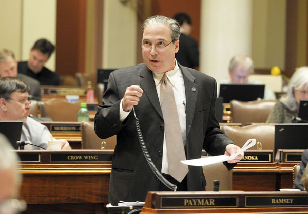 Rep. Michael Paymar presents the omnibus public safety finance bill on the House Floor April 24. (Andrew VonBank)
