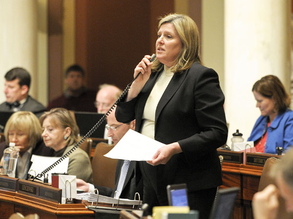 Rep. Ann Lenczewski presents the omnibus tax bill on the House Floor April 25. (Photo by Andrew VonBank)