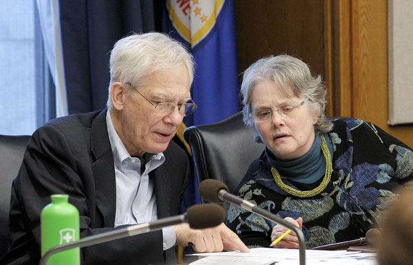Co-chairs Rep. Thomas Huntley and Sen. Linda Berglin confer during the May 12 omnibus health and human services finance conference committee meeting. (Photo by Andrew VonBank)