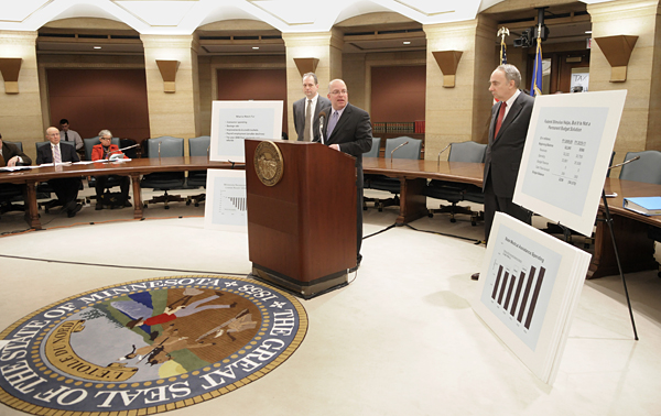 Finance Commissioner Tom Hanson discusses the February budget forecast at a March 3 press conference along with State Budget Director James Schowalter, left, and State Economist Tom Stinson. (Photo by Tom Olmscheid)