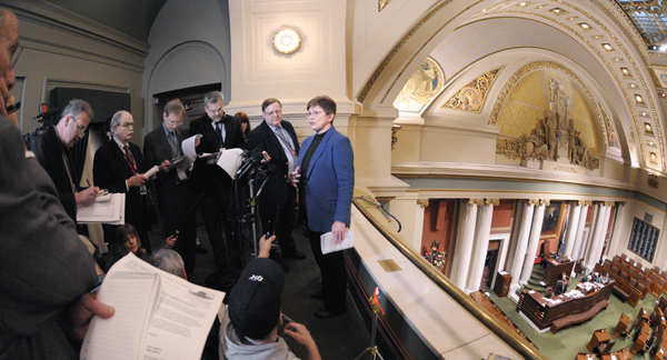 Rep. Alice Hausman, right, releases the $999.8 million House bonding proposal to media members during a Feb. 4 news conference in the House Gallery. Hausman, chairwoman of the House Capital Investment Finance Division, said the bonding bill should be ready for a floor vote Feb. 15. (Photo by Tom Olmscheid)