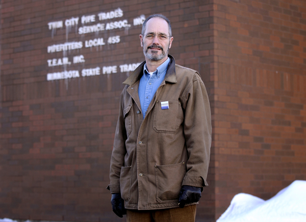 Rep. Tim Mahoney stands outside the Pipefitters Local 455 union hall in St. Paul. Mahoney, a pipefitter when the Legislature is not in session, lost his job last fall. (Photo by Tom Olmscheid)