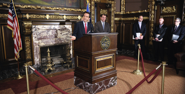 Gov. Tim Pawlenty releases his supplemental budget proposal at a Feb. 15 news conference. (Photo by Tom Olmscheid)