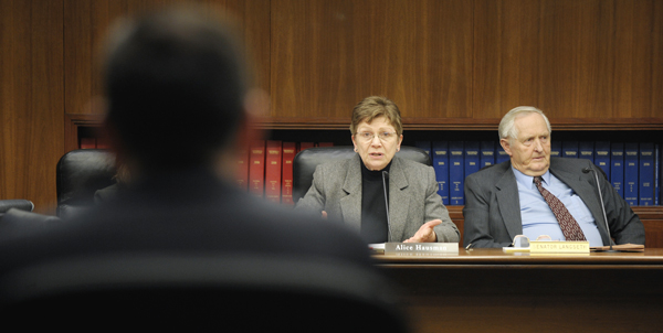 Chris DeLaForest, left, Gov. Tim Pawlenty�s director of Legislative and Cabinet Affairs, and Sen. Keith Langseth, right, listen as Rep. Alice Hausman asks a question during a Feb. 24 meeting of a working group of the Capital Investment Conference Committee. (Photo by Tom Olmscheid)