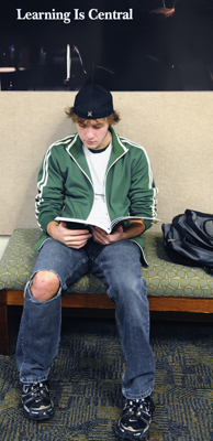 A student at Century College reads in the commons. (Photo by Tom Olmscheid)