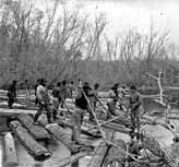 Lumbermen from Elias Moses' logging camp driving logs on the Rum River; Photographer: Whitney; Photograph Collection 1864; Photo courtesy of the Minnesota Historical Society