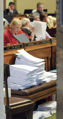 Amendments to the omnibus health and human services bill pile up on a bench in the House Chamber during a marathon nine hour debate May 4. (Photo by Andrew VonBank)