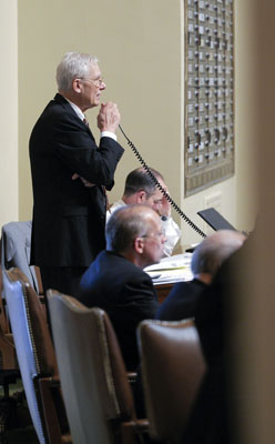 Rep. Thomas Huntley presents the omnibus health and human services bill on the House floor May 4. (Photo by Andrew VonBank)