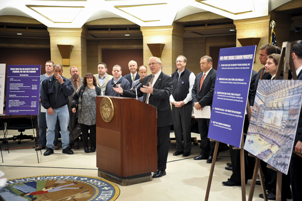 At a May 3 press conference, Rep. Loren Solberg, outlines the financing provisions of a stadium bill he sponsors. He said those who benefit from the facility should help pay for it. (Photo by Tom Olmscheid)