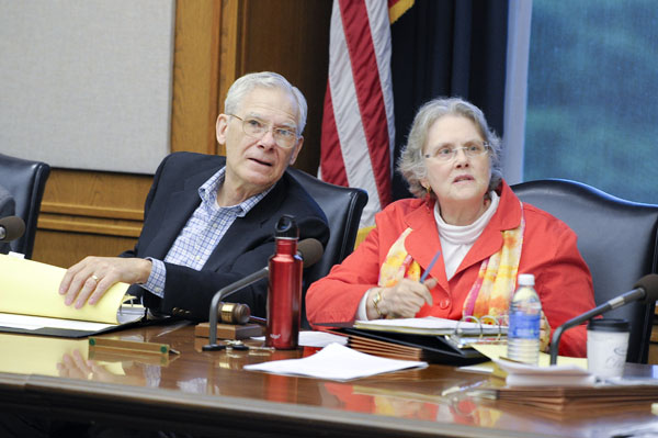 Rep. Thomas Huntley and Sen. Linda Berglin listen to the side-by-side comparison of the House and Senate health and human services bills during a May 7 conference committee meeting. (Photo by Andrew VonBank)