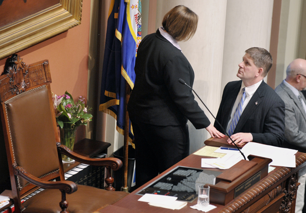 House Speaker Margaret Anderson Kelliher talks with House Minority Leader Kurt Zellers prior to the House taking up a budget-balancing bill during a one-day special session May 17. (Photo by Tom Olmscheid)
