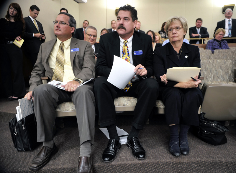 Faribault Mayor John Jasinski, from left, City Manager Tim Murray and Rep. Patti Fritz wait for their opportunity to testify before the House Finance Committee Oct. 18 about their cities flood damage. (Photo by Tom Olmscheid)