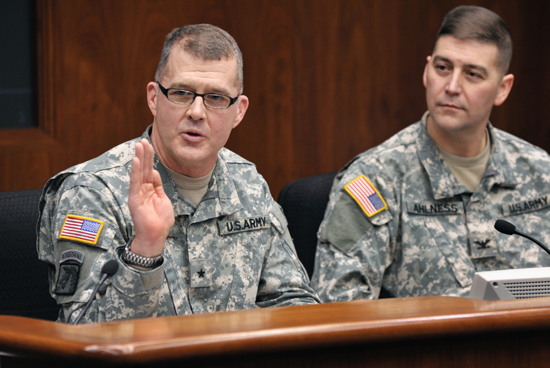 Brig. Gen. Joe Kelly, assistant adjutant general of the Minnesota National Guard, left, tells the House Veterans Services Division that all soldiers take two oaths when sworn into the Minnesota National Guard: one to uphold the U.S. Constitution and the other to uphold the state constitution. (Photo by Tom Olmscheid)