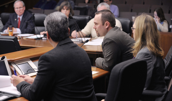 Rep. Carlos Mariani, left, sponsor of an alternative pathway to teacher licensure proposal, and Kelly Wolfe, right, who represents Teach for America, listen as Shannon Blankenship answers a question by a member of the House Education Reform Committee during a hearing Jan. 18. Blankenship is the founder of Hiawatha Leadership Academy, a Minneapolis charter school. (Photo by Tom Olmscheid)