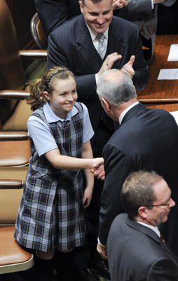 Ten-year-old Alice Lesch, daughter of Rep. John Lesch, gets a warm handshake from Gov. Mark Dayton after the State of the State address Feb 9. (Photo by Andrew VonBank)