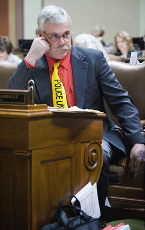 Rep. Tony Cornish listens as House members debate the combined omnibus public safety and judiciary finance bills. (Photo by Tom Olmscheid)