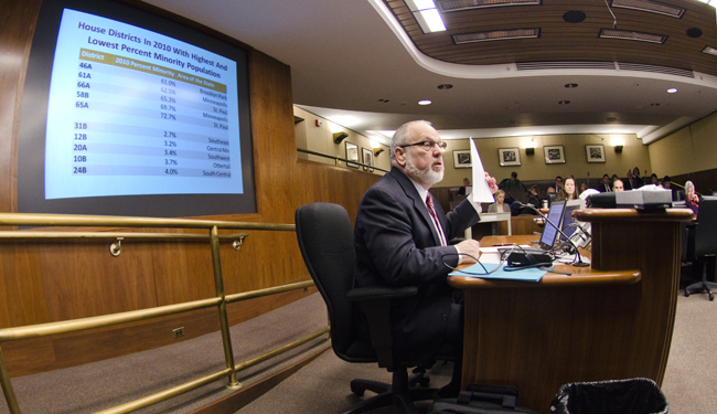 State Demographer Tom Gillaspy answers a question about House districts with the highest and lowest minority populations during a March 29 meeting of the House Redistricting Committee. (Photo by Tom Olmscheid)