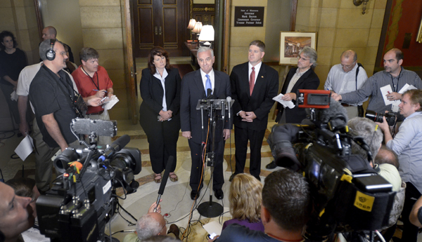 Senate Majority Leader Amy Koch, from left, Gov. Mark Dayton and House Speaker Kurt Zellers emerge from budget talks July 14 to report the framework of an agreement had been reached to end the state government shutdown. (Photo by Andrew VonBank)