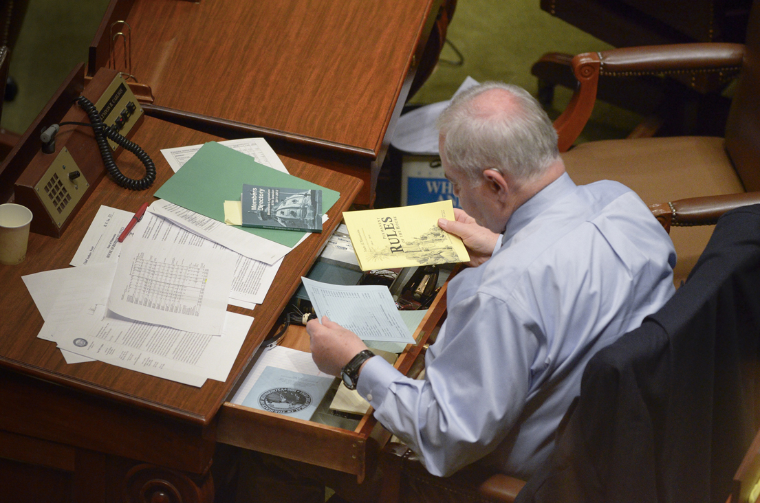 Rep. Lyndon Carlson Sr. cleans out his desk in the early morning hours of May 10, the last day of the 2012 session. Carlson has served in the Legislature for 40 years. (Photo by Andrew VonBank)