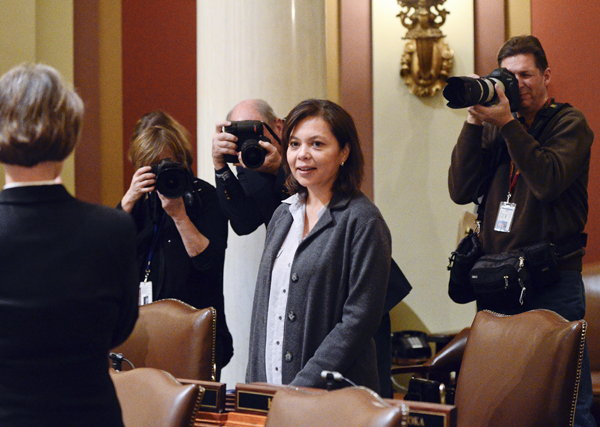 Rep. Susan Allen, the newest member of the Minnesota House of Representatives, is welcomed on the House floor by her colleagues Jan. 24. (Photo by Andrew VonBank)