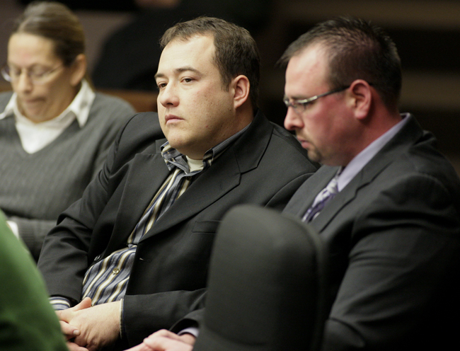 Rep. Chris Swedzinski, center, listens Jan. 26 during testimony about his bill that would authorize the Department of Agriculture to inspect feed operations and to issue Good Manufacturing Practices certificates. Seated with him is Matt Frederking, director of regulatory affairs and operations for Ralco Nutrition in Marshall. (Photo by Paul Battaglia)