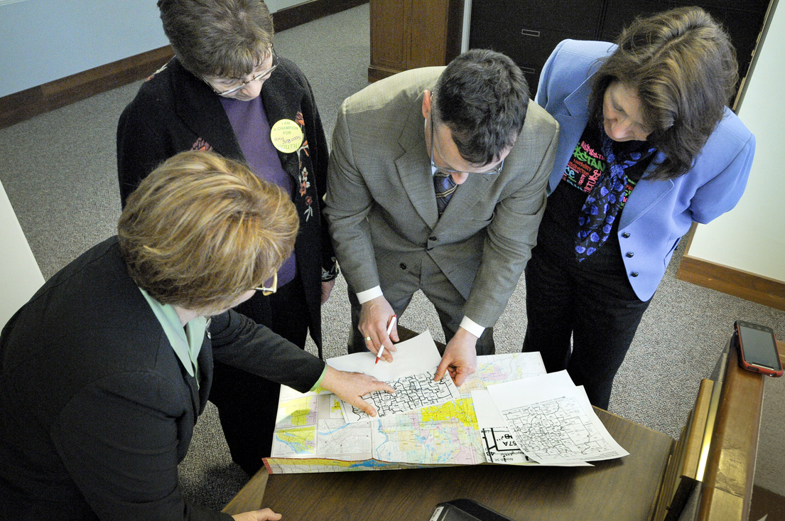 From left: Reps. Erin Murphy, Alice Hausman and John Lesch and Sen. Mary Jo McGuire scrutinize the newly released district maps Feb. 21. (Photo by Andrew VonBank)