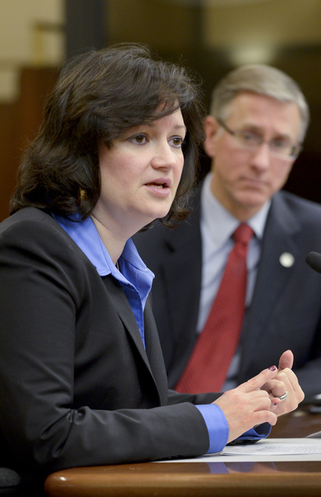 Amy Sweasy, senior attorney with the Hennepin County Attorney's Office, testifies before the House Judiciary Policy and Finance Committee Feb. 16 in support of a bill that would modify the penalty for criminal neglect of a vulnerable adult. The bill's sponsor, Rep. Steve Gottwalt, listens to the testimony. (Photo by Andrew VonBank)