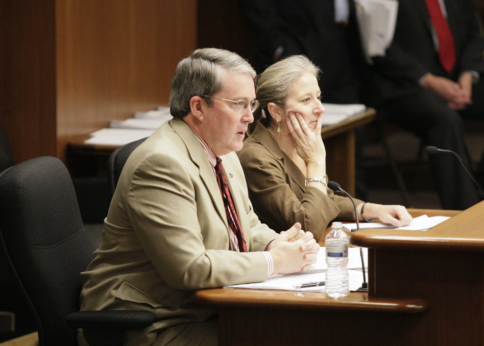 Rep. Michael Beard, left, and lobbyist Lisa Frenette discuss HF2169 with members of the House State Government Finance Committee March 6. The bill would increase legislative scrutiny of administrative rules. (Photo by Paul Battaglia)