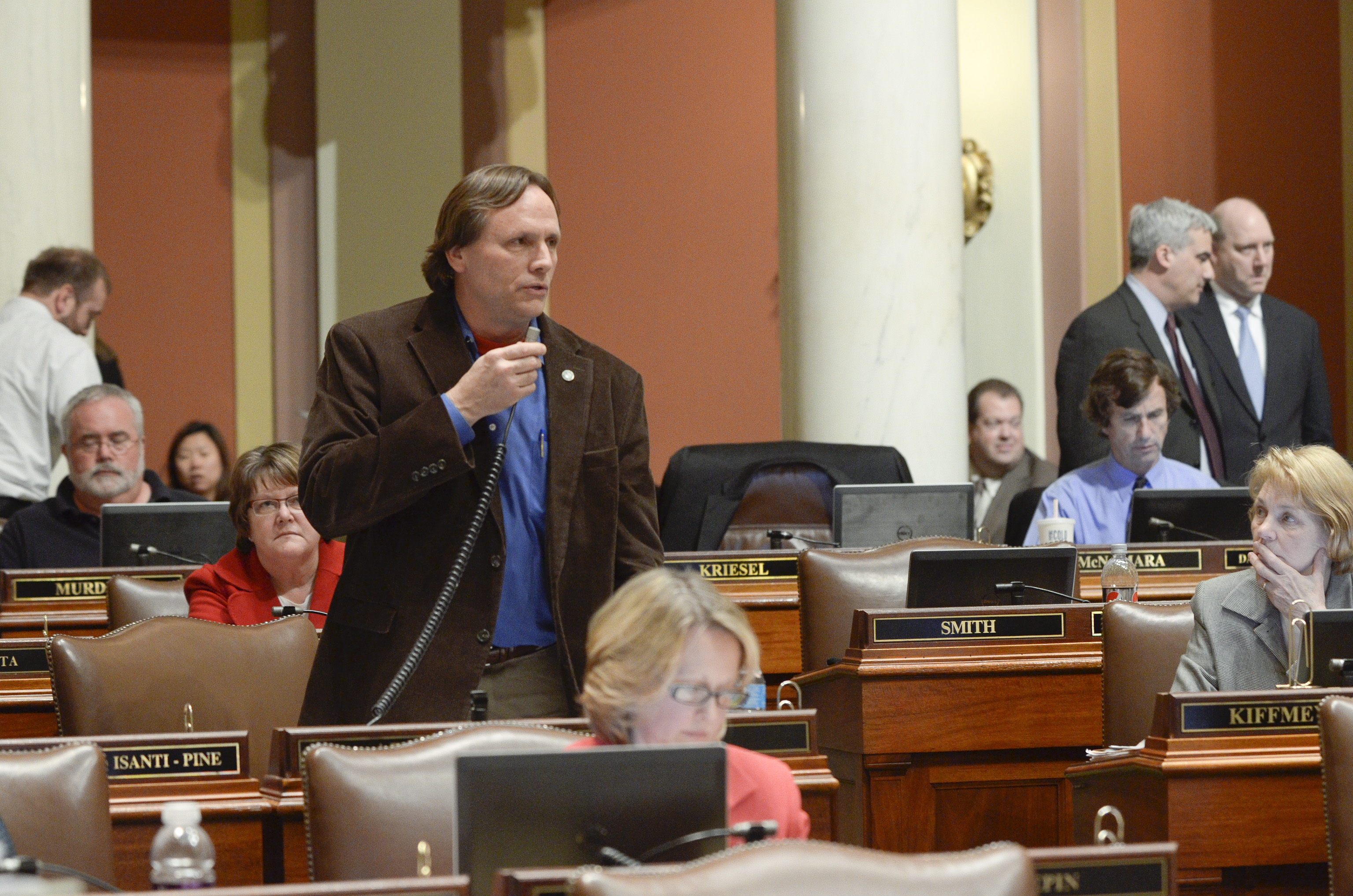 Rep. Jim Abeler presents the omnibus health and human services finance bill March 29 on the House floor. (Photo by Andrew VonBank)